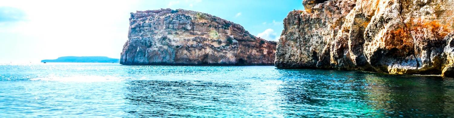 rock boulders blue mediterranean sea